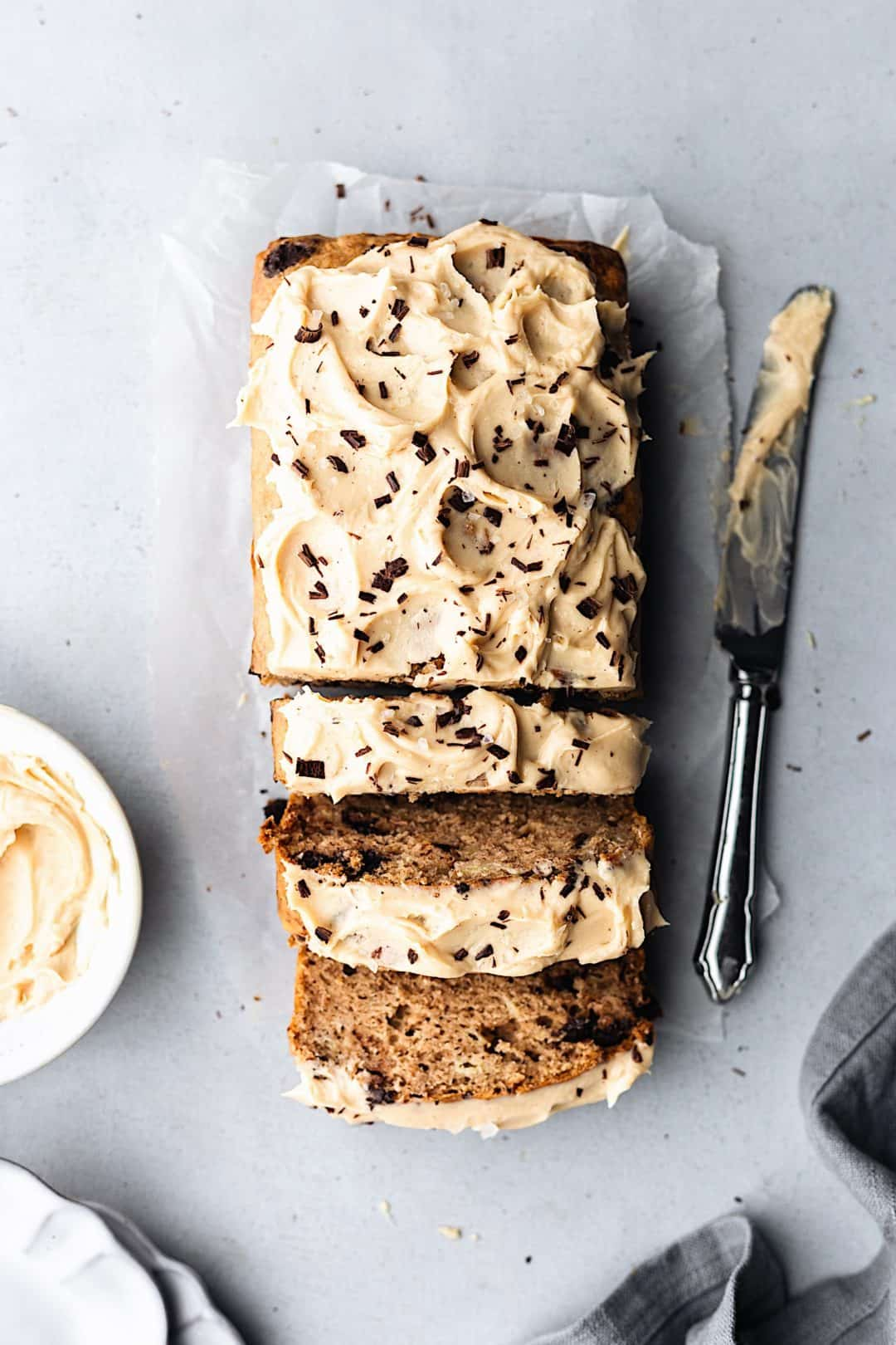 Vegan Chocolate Chip Banana Bread with Peanut Butter Frosting #vegan #recipe #cake