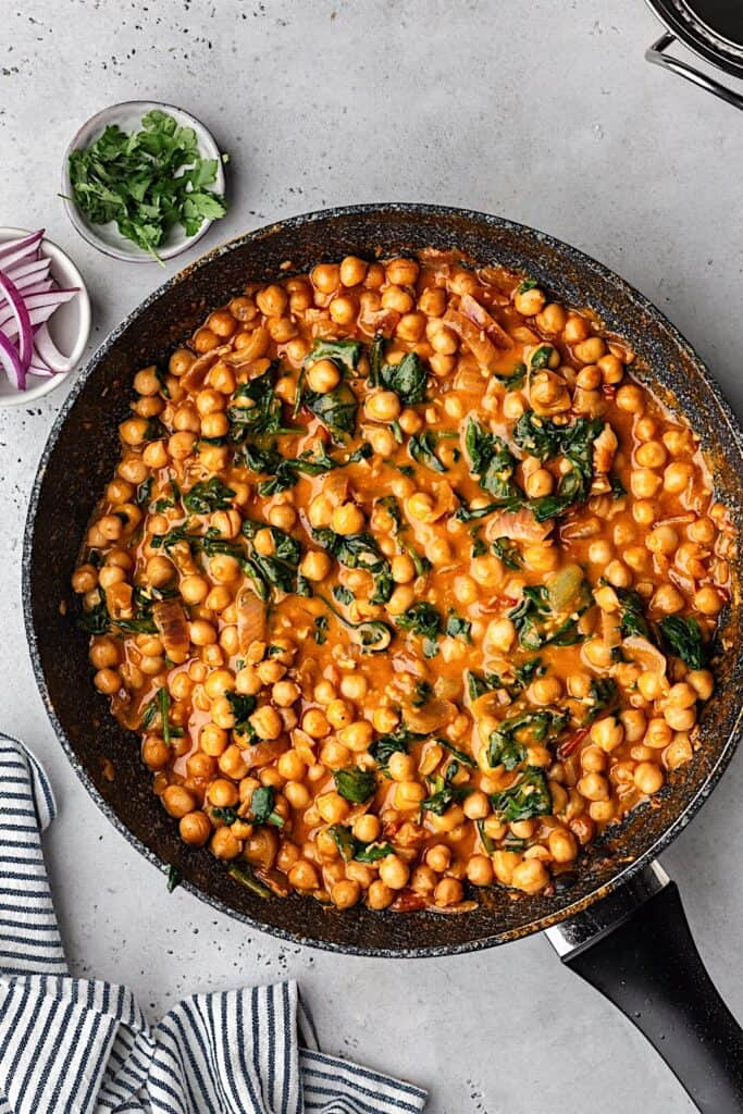 Chickpea and Spinach Curry in Saucepan #vegan #curry #food #recipe #chickpea #spinach #creamy