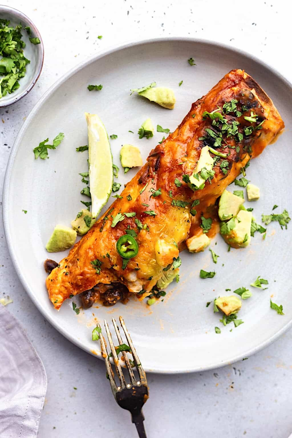 Vegan Black Bean and Sweet Potato Enchiladas #sweetpotato #blackbeans #mexican #vegan #recipe #enchiladas